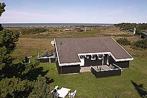 Holiday home. Built in 1985. Renovated in 2009. Situated on a 2700 qm site. Sea view from house and site. The house is heated by electricity. 1 bathroom with shower. 1 toilet. At least one bathroom wi ...