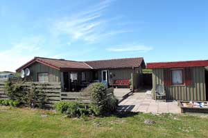 Holiday home. Built in 1982. Situated on a 1200 qm site. The house is heated by electricity. 1 bathroom with shower. 1 toilet. Freezer. Oven/minioven. Woodburning stove. Analog satellite dish. 3 bedro ...