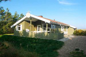 Holiday home. Built in 1986. Renovated in 2006. Situated on a 1250 qm site. Sea view from house and site. The house is heated by electricity. 1 bathroom with shower. 1 toilet. At least one bathroom wi ...