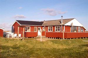 Holiday home. Built in 1975. Renovated in 2004. Situated on a 2570 qm site. The house is heated by electricity. 1 bathroom with shower. 1 toilet. Microwave oven. Oven/minioven. Woodburning stove. Ster ...