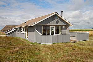 Holiday home. Built in 1975. Renovated in 2006. Situated on a 2500 qm site. The house is heated by electricity. 1 bathroom with shower. 1 toilet. Freezer. Microwave oven. Dish washer. Woodburning stov ...