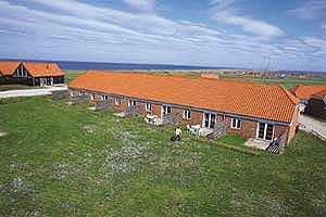 Holiday home. Built in 1989. Situated on a 200 qm site. Sea view from the site. The house is heated by electricity. 1 bathroom with shower. 1 toilet. Freezer. Microwave oven. Stereo set. CD. Communal  ...