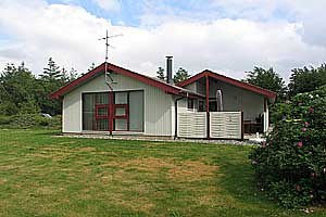 Holiday home. Built in 1986. Situated on a 2900 qm site. The house is heated by electricity. 1 bathroom with shower. 1 toilet. Freezer. Microwave oven. Dish washer. Woodburning stove. Stereo set. CD.  ...