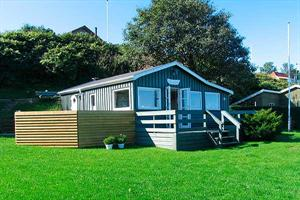 Holiday home. Built in 1991. Renovated in 2007. Situated on a 748 qm site. Sea view from house and site. The house is heated by electricity. 1 bathroom with shower. 1 toilet. Stereo set. CD. DVD. High ...