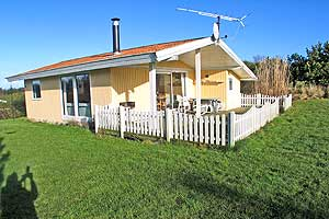 Holiday home. Built in 1977. Renovated in 2004. Situated on a 1200 qm site. The house is heated by electricity. 1 bathroom with shower. 1 toilet. Freezer. Dish washer. Woodburning stove. CD. Analog sa ...