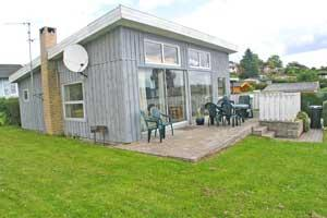 Holiday home. Built in 1960. Renovated in 2001. Situated on a 400 qm site. Sea view from house and site. The house is heated by electricity. 1 bathroom with shower. 1 toilet. Freezer. Microwave oven.  ...