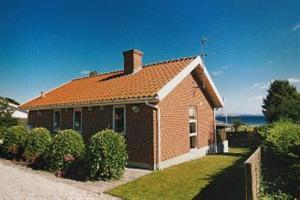 Holiday home. Built in 1996. Situated on a 350 qm site. Sea view from the house. The house is heated by electricity. 1 bathroom with shower. 1 toilet. At least one bathroom with heated floor. Microwav ...