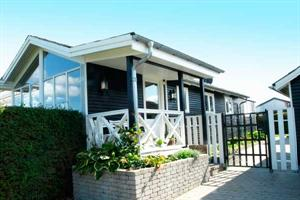 Holiday home. Renovated in 1997. Situated on a 600 qm site. The house is heated by electricity. 1 bathroom with shower. 2 toilets. Freezer. Microwave oven. Oven/minioven. Woodburning stove. Stereo set ...