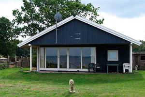 Holiday home. Built in 1966. Renovated in 2003. Situated on a 1000 qm site. Sea view from house and site. The house is heated by electricity. 1 bathroom with shower. 1 toilet. At least one bathroom wi ...