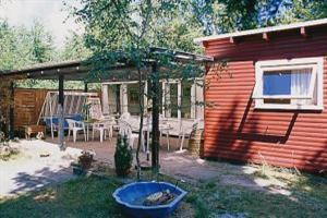 Holiday home. Built in 1965. Renovated in 2004. Situated on a 1453 qm site. The house is heated by electricity. 1 bathroom with shower. 1 toilet. Oven/minioven. Woodburning stove. CD. Digital satellit ...