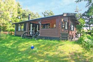 Holiday home. Built in 1972. Situated on a 3000 qm site. The house is heated by electricity. 1 bathroom with shower. 1 toilet. Freezer. Oven/minioven. Woodburning stove. Stereo set. CD. Digital satell ...