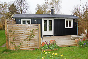 Holiday home. Built in 1964. Renovated in 1998. Situated on a 1000 qm site. The house is heated by electricity. 1 bathroom with shower. 1 toilet. Freezer. Dish washer. Woodburning stove. Stereo set. C ...